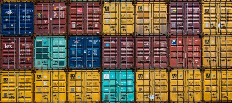 shipping containers stacked on top of each other