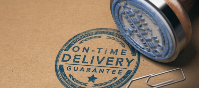 stamp that says on-time delivery